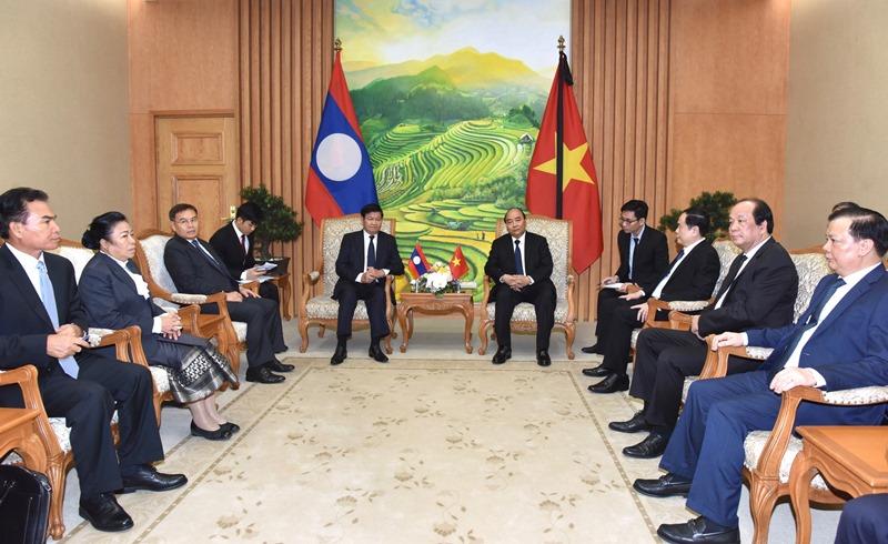 Thủ tướng Nguyễn Xuân Phúc tiếp Thủ tướng Lào Thongloun Sisoulith -0